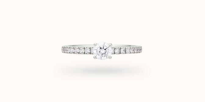 Bague solitaire quatre griffes - Or blanc 18K (2,20 g), diamants 0,10 ct - Courbet
