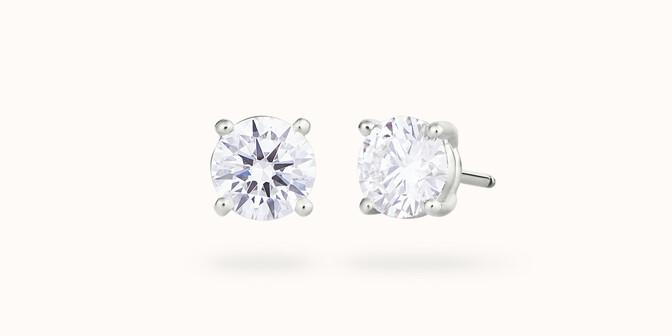 Puces d'oreilles quatre griffes - Or blanc 18K (2,00 g), diamant 0,6 ct